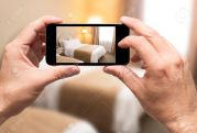 59288224-Taking-picture-in-hotel-room-with-smartphone-Stock-Photo